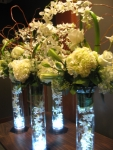 White centerpiece featuring curved callas