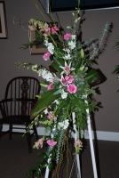 White wood easel featuring stargazer lilies