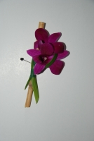 Dendrobium orchid boutonniere with bamboo and grass accent