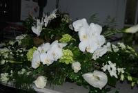Elegant white casket spray